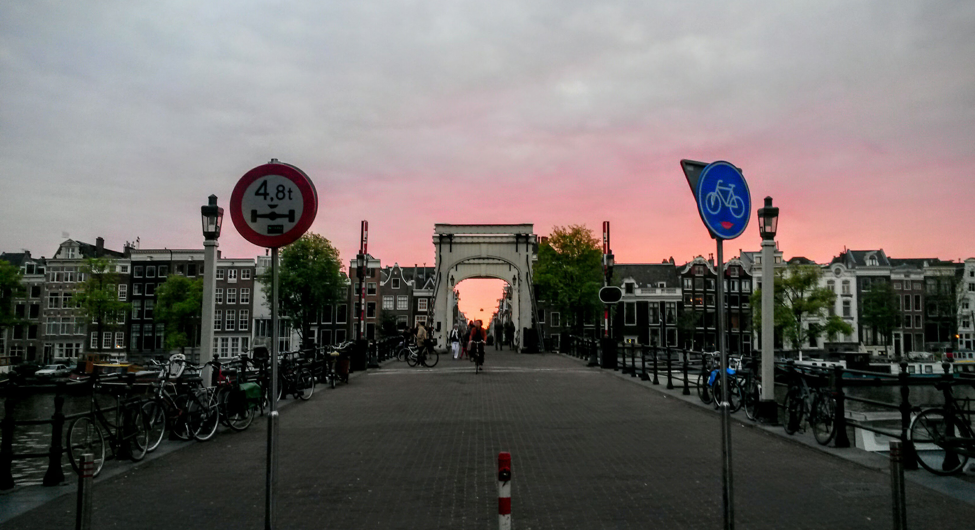 humanlike.co places amsterdam skinny bridge sunset