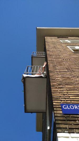 humanlike.co man on balcony amsterdam